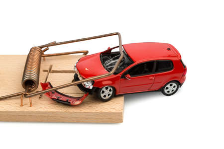 indebtedness: a model car in a mousetrap, symbolic photo for car expenses and debts Stock Photo