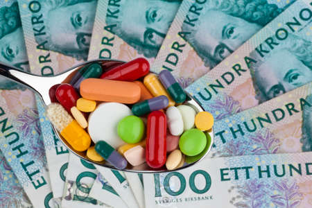 medizin: swedish krona, the currency of sweden  with tablets  health costs