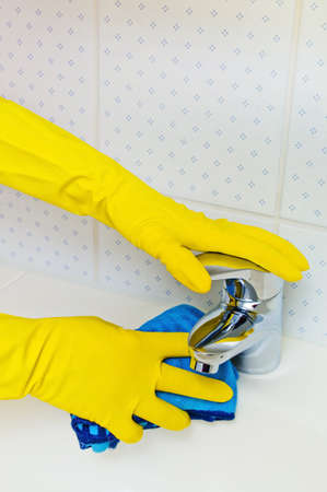 the sink of a bathroom is cleaned with latex gloves  Stock Photo - 17633700