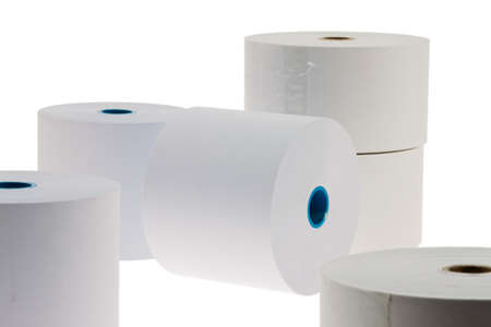 exempt: white paper rolls lying on a white background  isolated and exempt