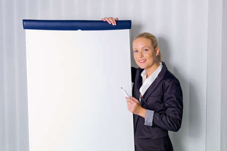 a young woman with a flip chart board during a presentation  training and adult education  photo