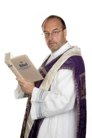 chastity: a catholic priest with a bible in worship