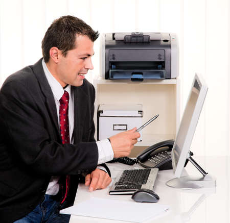 freelancers: young businessman in office with computer