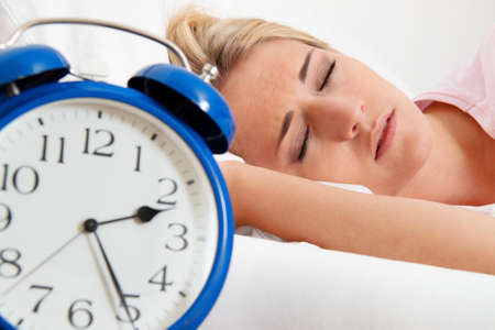 doze: insomnia with clock in the night  woman can not sleep