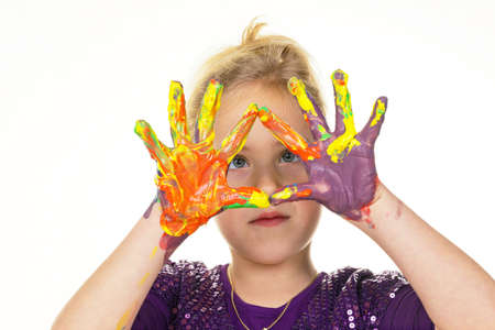 a small child with finger paints colors  funny and creative  photo