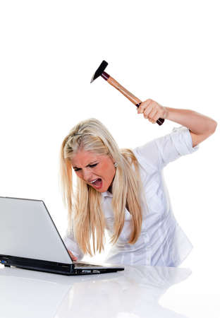 discouraged: woman with computer problems, hammer and laptop  Stock Photo