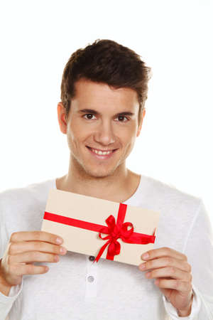 man holding a gift card in his hand  gift certificate  photo