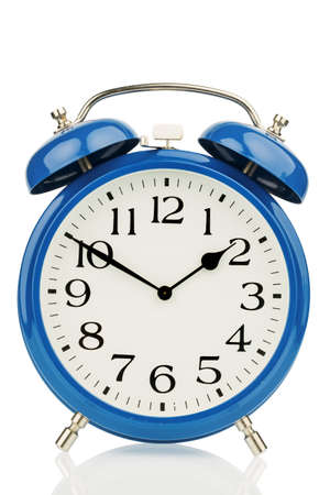 past: a blue alarm clock on a white background  a wake white dial Stock Photo
