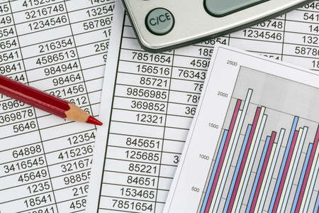 vat: a calculator is on a balance sheet numbers are statistics  photo icon for sales, profit and cost