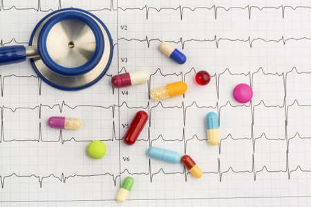 arrhythmias: several tablets are on an ekg  symbolic photo for diseases of the cardiovascular system