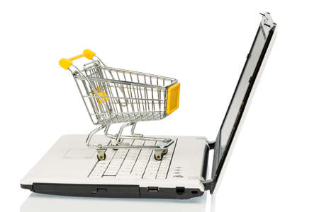 an empty cart on a laptop computer  symbolic for internet shopping Stock Photo - 18031158