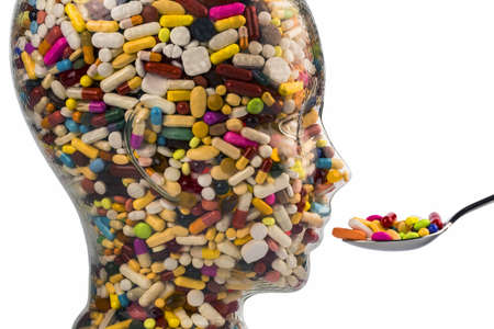 drug abuse: a head made of glass filled with many tablets  photo icon for drugs abuse and addiction tablets