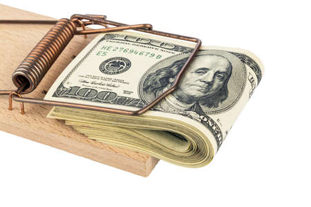 u s: u s  dollar bills in a mousetrap  symbolic photo for debt