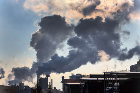 particulate: chimney of an industrial company with smoke  symbolic photo for environmental protection and ozone