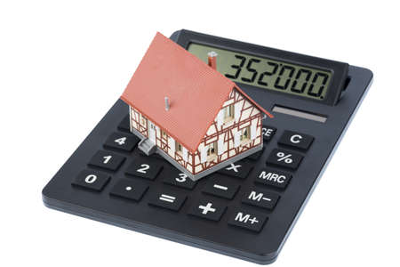 financial burden: house on a calculator, photo icon for house purchase, costs and savings