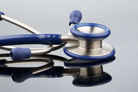 intercept: stethoscope against white background, photo icon for the medical profession and diagnosis