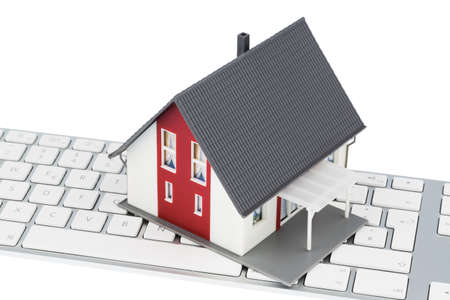 vacation home: house on keyboard symbol photo for house purchase and rental on the internet