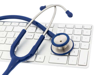 edv: stethoscope and a computer keyboard, symbolic for diagnosis and event management Stock Photo