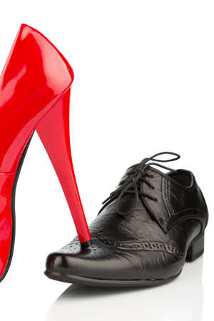 dominance: ladies shoes on men s shoe, symbol photo for separation, divorce and conflict Stock Photo