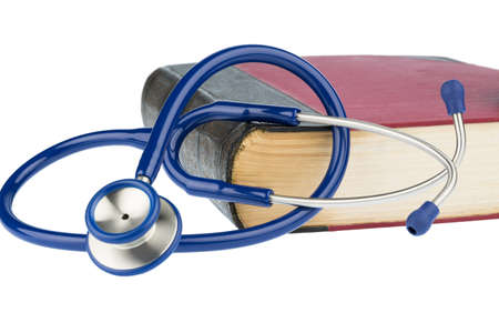 quite time: book and stethoscope, symbol photo for bungling, doctors mistake and expertise Stock Photo