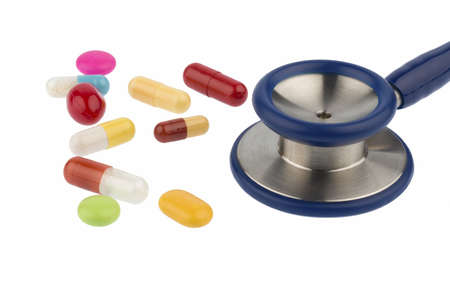 sleeping tablets: colorful tablets and a stethoscope, symbol for diagnosis, heart disease and interactions Stock Photo