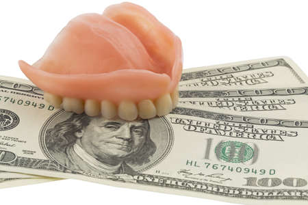 dentures and dollar bills symbol photo of dentures, treatment costs and payment photo