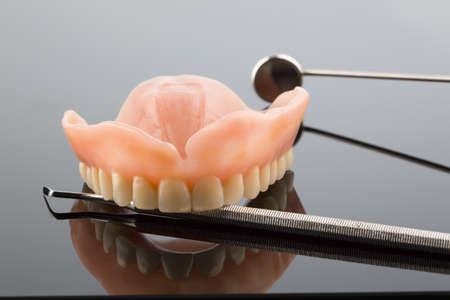 teeth and dental mirror, symbol photo of dentures, diagnosis and copayment photo