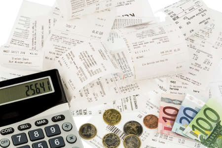 expenditure: calculator, receipts and money symbol photo for savings, purchasing power and inflation