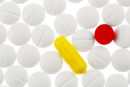 white and colored tablets, symbolic photo for medicine, remedies and pills addiction Stock Photo - 18031283