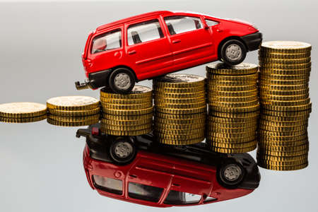 fees: in a car you have rising costs by fuel, insurance, parking fees and tolls  Stock Photo