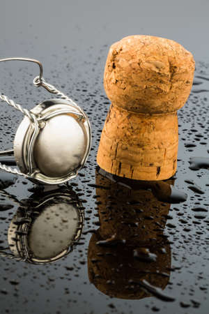 solemnity: champagne corks and brooch, symbol photo for celebrations, enjoyment and consumption of alcohol Stock Photo