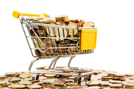 consumerist: a shopping cart is filled with well-euro coins, symbolic photo for purchasing power and consumption