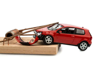 liability insurance: a model car in a mousetrap, symbolic photo for car expenses and debts Stock Photo