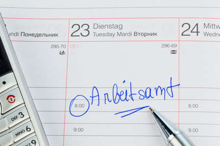 entlassen: a date is entered in a calendar  employment office