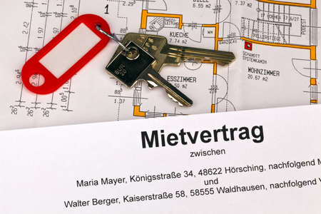 accommodation space: a lease and a plan in german  symbolic picture rental or purchase of homes