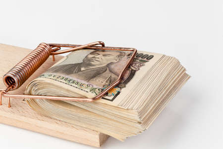 yen bills from japan in a mousetrap Stock Photo - 18055190