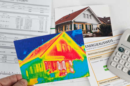thermal energy: saving energy through insulation  house with thermal imaging camera photographed