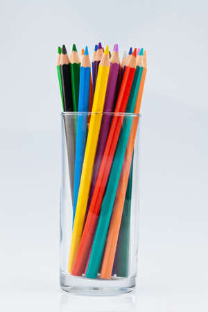stationery needs: crayons many different colors in a glass