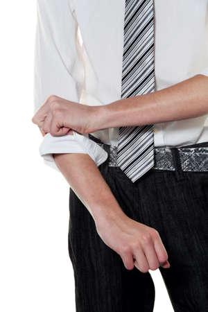 diligente: un hombre joven y exitoso se arremanga Foto de archivo