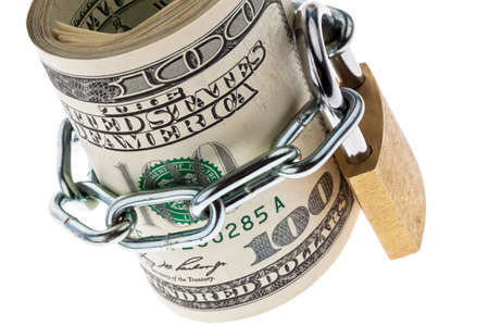 safe investment: many dollar bills are locked with a lock