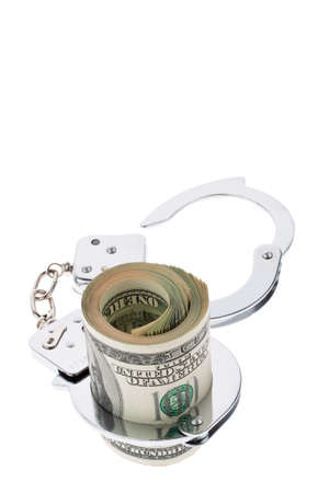 drug bust: many dollar bills with handcuffs