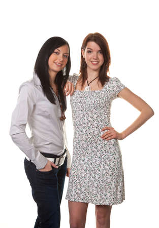 peoplesoft: two young girls whispering to the latest news Stock Photo
