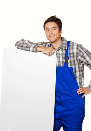 hobbyist: a young craftsman, plumber, construction worker with empty poster