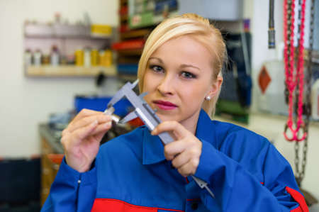 workpiece: an apprentice  apprentice  in the metal industry  measure a workpiece in the workshop  rare female occupations