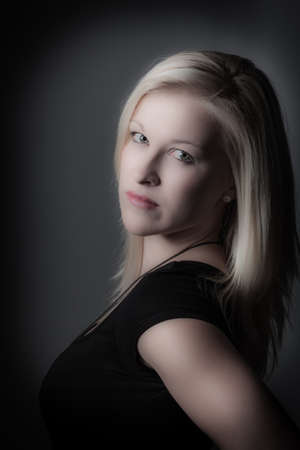 portrait of a young woman with long blond hair in the studio Stock Photo - 18053392