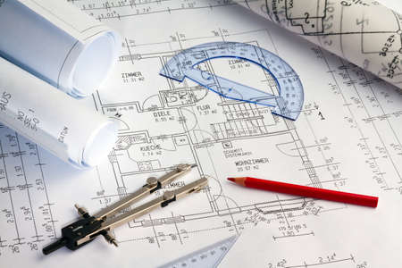 architect drawing: blueprint for a house  drawings and plans of an architect