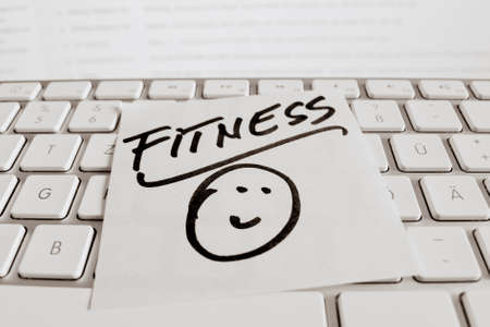 freetime activity: a memo is on the keyboard of a computer as a reminder  fitness Stock Photo