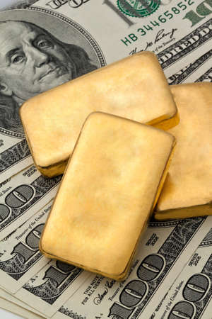 dollar bills: investment in real gold than gold bullion and gold coins