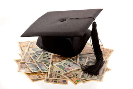 examiert: mortar board and the yen  symbolic photo for education expenses in japan