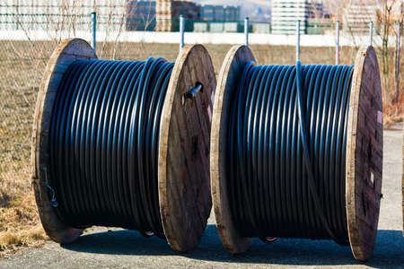 curren: a power line cable rolled up after production  Stock Photo
